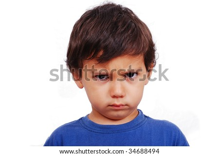 Cute kid with angry expression on his face - stock photo