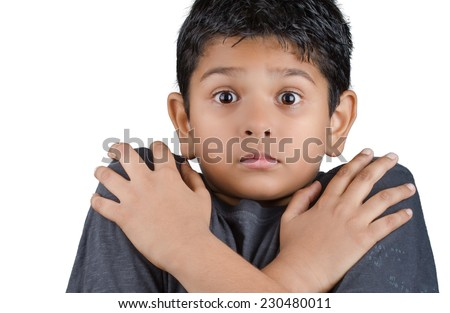 cute kid with expression of fear - stock photo