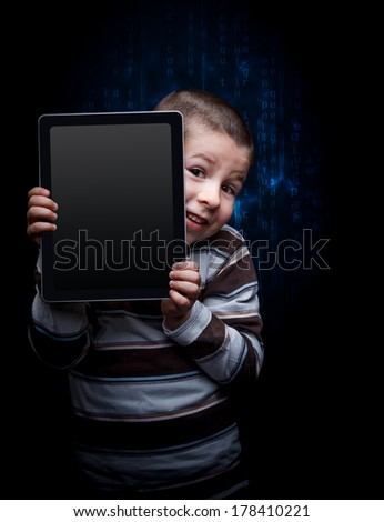 Cute kid with tablet, keek - stock photo