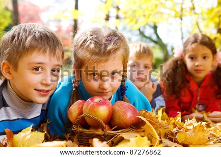 Cute kids and apples basket