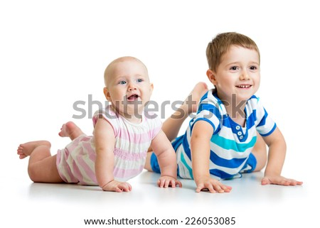 Cute kids brother and sister lying on floor isolated - stock photo