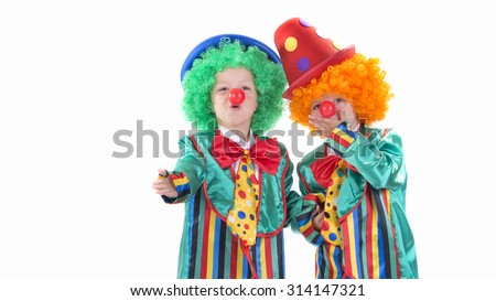 cute kids clowns throwing a kiss - stock photo