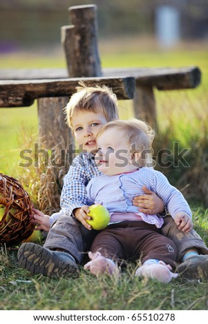 Cute kids having fun at countryside - stock photo
