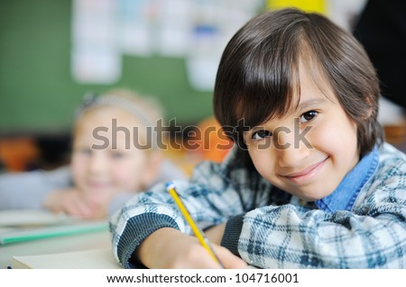 Cute kids in school - stock photo