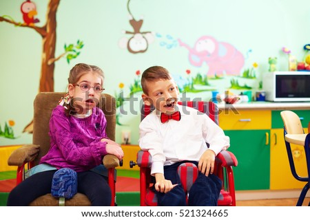 cute kids in wheelchairs at kindergarten for children with special needs