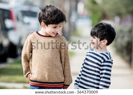 Cute kids interacting with each other - stock photo