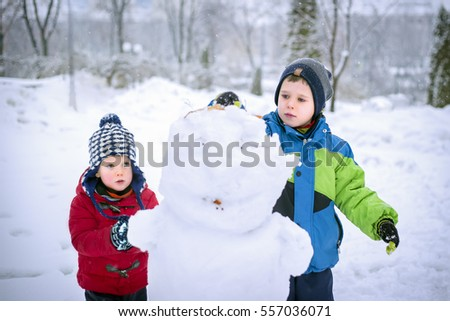 Cute kids playing outdoors in winter