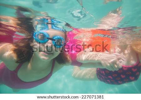 Cute kids posing underwater in pool at the leisure center