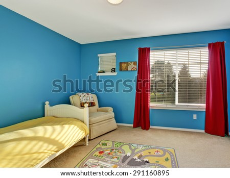 Cute kids room with blue walls and carpet. - stock photo
