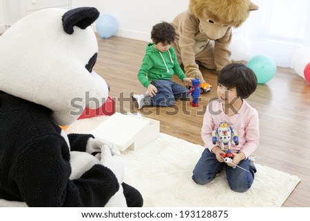 Cute Korean kids playing with toys