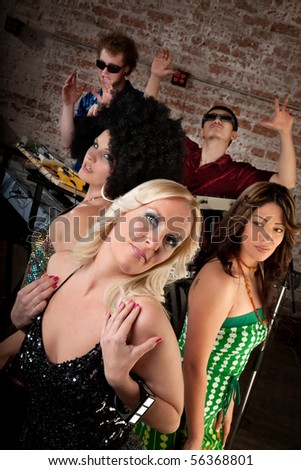 Cute ladies posing at a 1970s Disco Music Party - stock photo