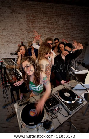 Cute lady DJ at a 1970s Disco Music Party - stock photo