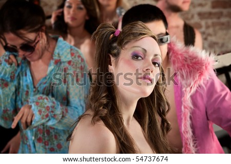 Cute lady posing at a 1970s Disco Music Party - stock photo