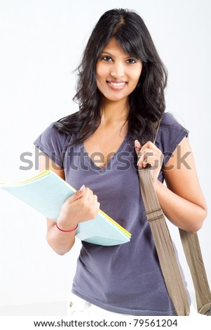 cute latin college student studio portrait - stock photo