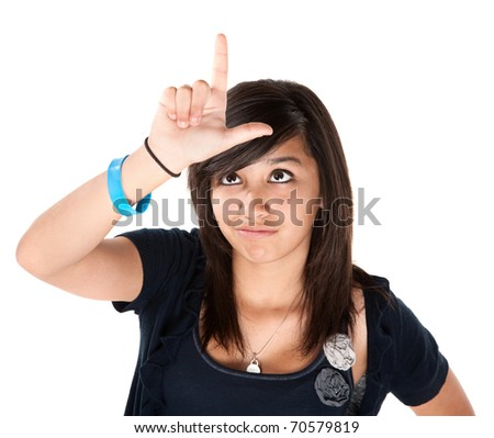 Cute Latino Making the Loser Sign on her Forehead - stock photo