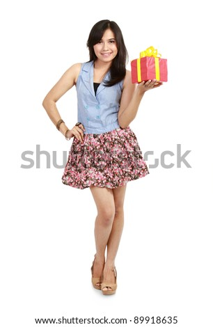 Cute laughing girl holding the red box present over white background - stock photo