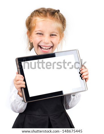 cute laughing schoolgirl with a pc tablet on a white background - stock photo