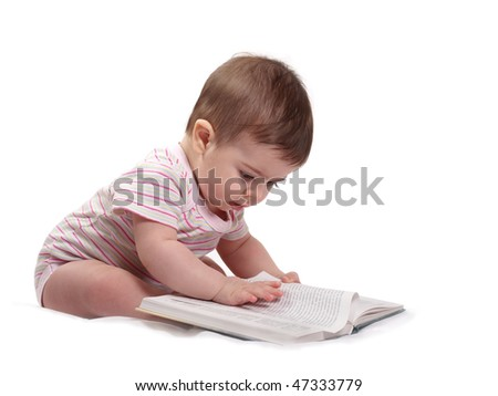 Cute litle baby reading a book - stock photo