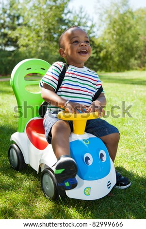 Cute little african american baby boy playing at park - stock photo