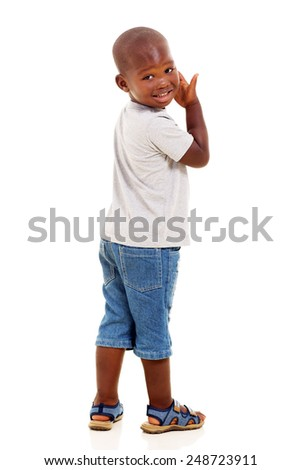 cute little african american boy looking back isolated over white background - stock photo