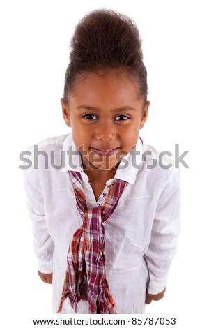 Cute little African Asian girl looking up,  over white background