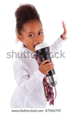 Cute little African Asian girl singing,  over white background - stock photo