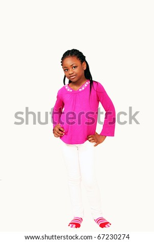 Cute little african girl with hands on waist, vertical image with lot of copy space