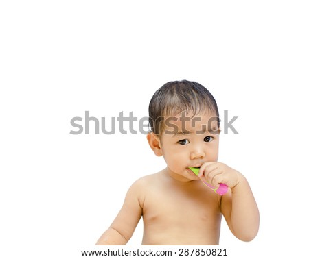 Cute little asian boy brushing teeth