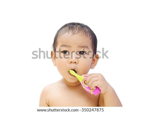 Cute little asian boy brushing teeth - stock photo