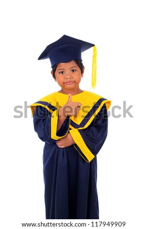 Cute little asian boy in graduation gown with good sign action isolated on white