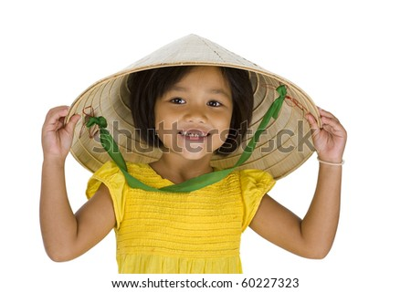 cute little asian uptown girl with vietnamese style hat and missing teeth, isolated on white background - stock photo