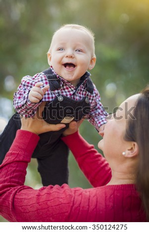 Cute Little Baby Boy Having Fun With Mommy Outdoors. - stock photo