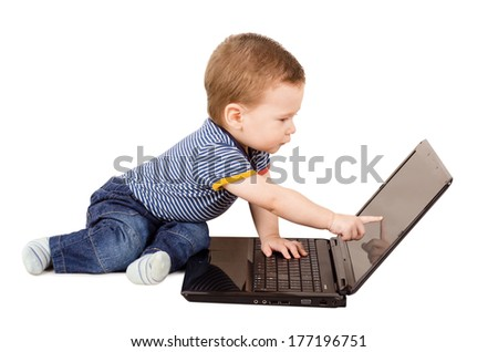Cute little baby boy using laptop isolated on white background - stock photo