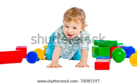 Cute little baby boy with colorful building block - stock photo