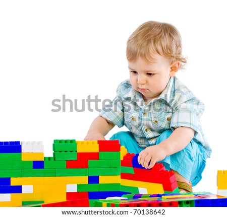 Cute little baby boy with colorful building block