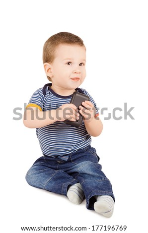 Cute little baby boy with mobile phone sitting on the floor isolated on white background