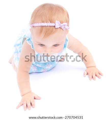 Cute little baby crawling in the studio over white background, small nice child having fun indoors, playful and carefree childhood - stock photo
