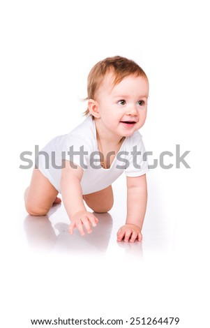 Cute little baby crawling isolated on white - stock photo