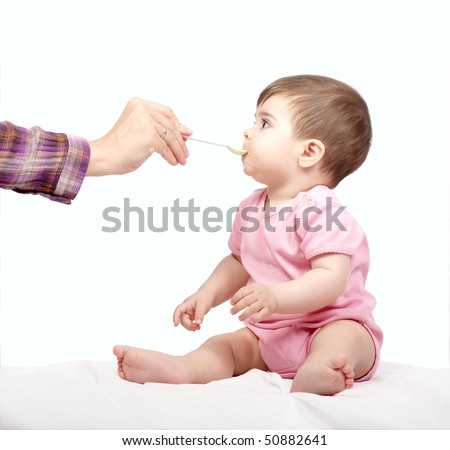 Cute little baby eat food - stock photo