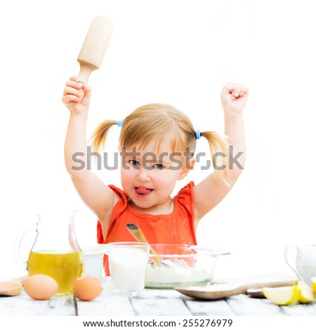 cute little baby girl baking with hands up isolated on a white background - stock photo