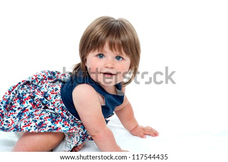 Cute little baby girl crawling isolated on white