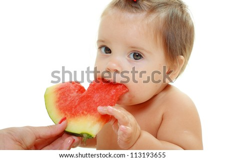 cute little baby girl eating watermelon slice on white background - stock photo