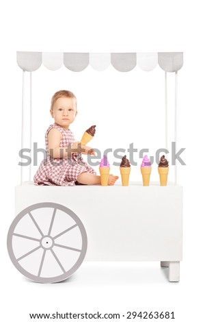 Cute little baby girl holding an ice cream cone seated on an ice cream stand isolated on white background - stock photo