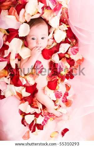 Cute little baby girl on the tulip petals