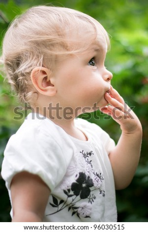 Cute little baby girl outdoors - stock photo