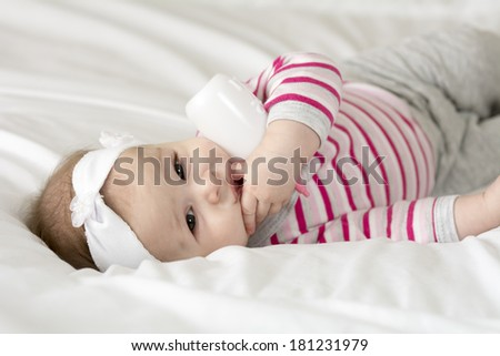 Cute little baby girl playing in bed  - stock photo