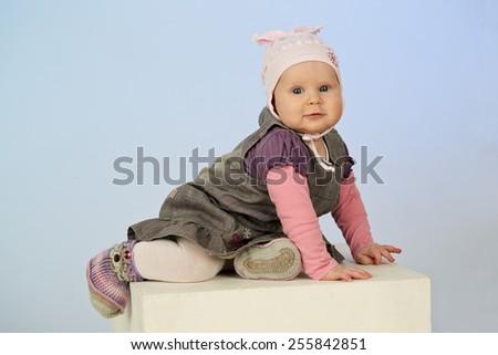 cute little baby girl posing in a studio - stock photo