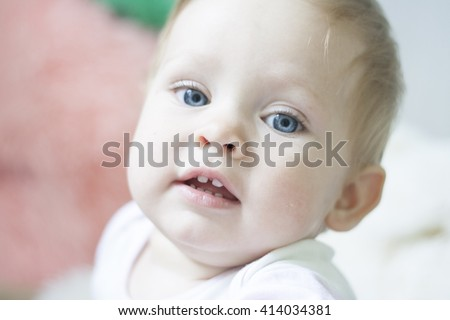 Cute little baby in high key with many light. Pretty children infancy and people age concept. Beautiful happy girl boy child face adorable portrait. Son daughter childhood. Wise expression kid. - stock photo