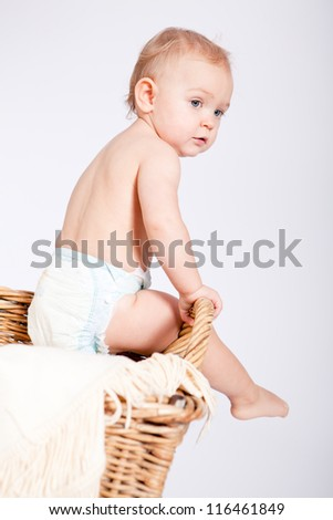cute little baby infant in basket with white teddy bear