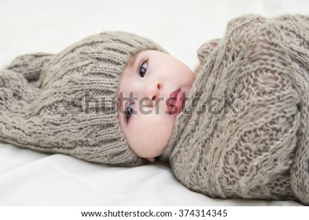 Cute little baby. Newborn baby girl in pink knitted hat. Parenting or love concept.  - stock photo